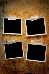 Four blank photographs on a wooden background