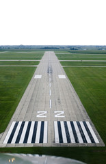 Looking down the runway of a rural airport.