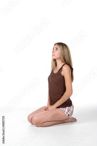 teenage girl kneeling and looking up stock photo and royalty free