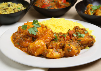 Chicken Pathia curry with Bombay aloo and pilau rice