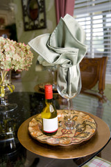 table place setting with individual wine bottle