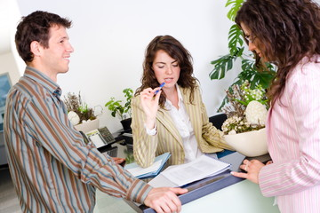 Casual business team working together at office reception