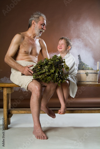 Old man with a little boy in the bath\