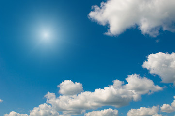 white clouds over deep blue sky background
