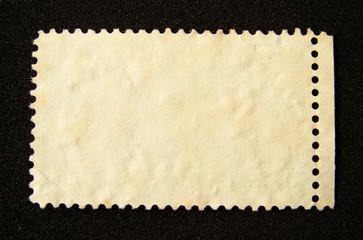 Blank postage stamp on black background.