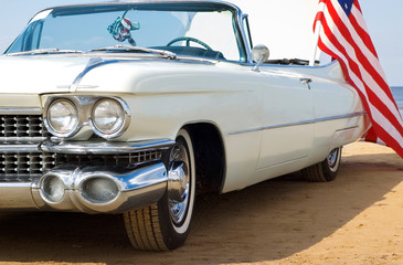 Aluminium Prints Old cars Classic white Cadillac at the beach with American flag