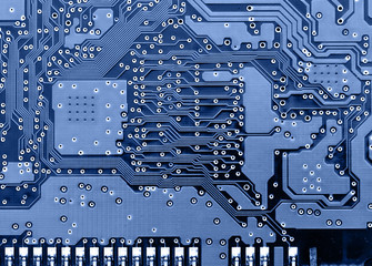 Circuit board super close-up toned in blue color