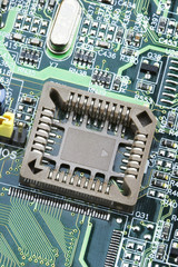 An photo of the front side of green computer mother board.