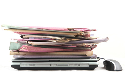 Isolated stack of folders with laptop computer