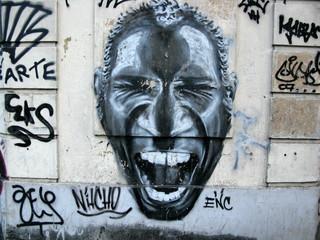 Homme qui rit, graffiti sur palissade, Rio de Janeiro, Brésil.