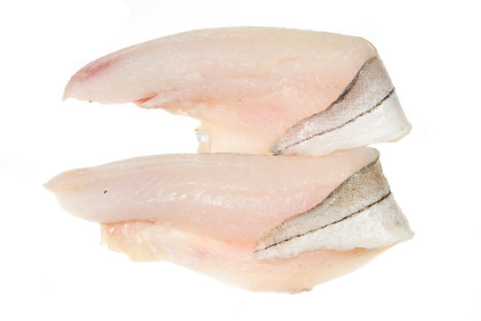 Two haddock fillets on a white background