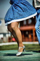 Country festival: girl dancing on the stage.