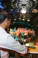 man enjoy live music in pub or bar