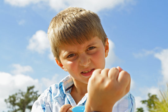 Child showing his fist