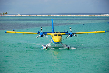 Seaplane arrives to a place of parking, Maldives