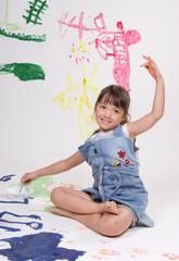 Girl is enjoying painting.