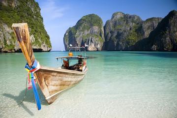 A longtail boat sits in Maya Bay, Koh Phi Phi Ley, Thailand