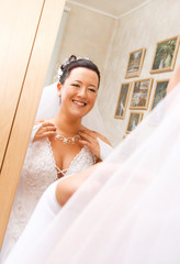 bride looking at her reflection in the mirror