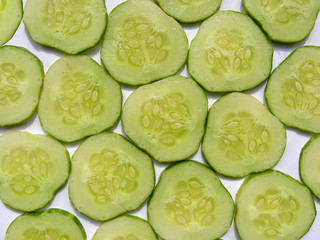Cutted cucumber slices background