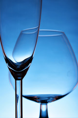 Still-life with empty glasses over blue background