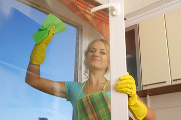 Women cleaning a window 2