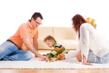 Family with baby boy ( 2 years old ) sitting on floor at home