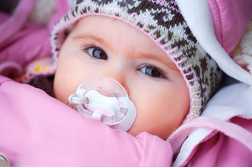 2 months old baby outdoor in warm clothes, winter