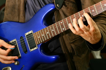 man play solo on blue guitar