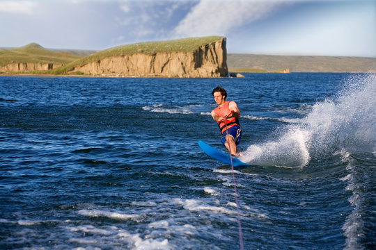 A man water skiing on a lake