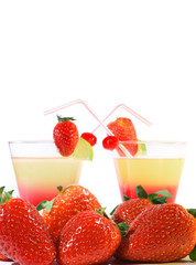 two sweet coctails and fresh strawberries