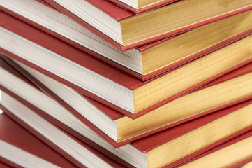 Burgundy Covered Stack of Books Close Up.