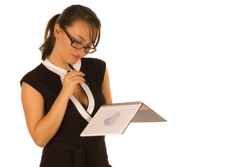 Pretty young woman drawing heart in copy-book isolated