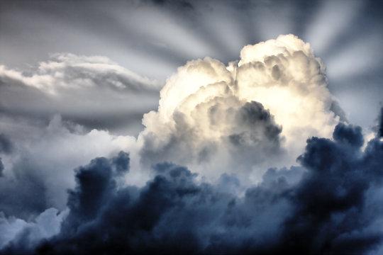 sun rays struggle through the storm clouds