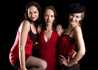 Three attractive woman posing for a shot with cabaret clothing
