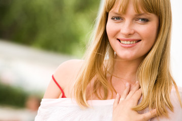 Photo of attractive blond lady looking at camera with smile