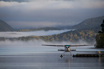 A landed waterplane - in the foggy hills