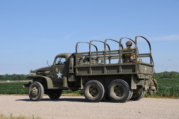 Wall Mural - World War II era military truck on a country road