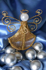 Golden Christmas tree angel amongst silver decorations