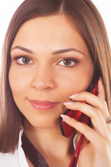 Attractive young woman calling by phone