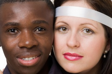 Two faces close up. Black man and white woman.