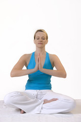 Attractive blonde woman in Yoga position