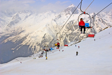Mountain skiers on pendant road