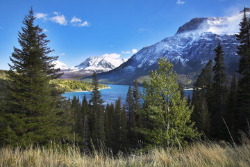 Turquoise lake in an environment of  fur-trees and mountains