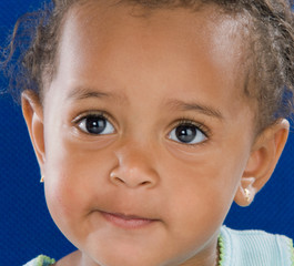 Adorable baby african a over blue background