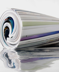 rolled up magazine with reflection