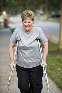 woman on crutches with pain