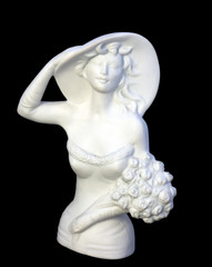 White plaster statuette of elegant woman with flowers