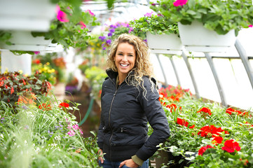 Beautiful woman with in the greenhouse.