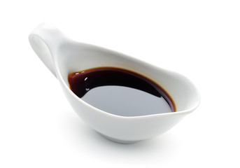 Soy Sauce in Suace-boat. Isolated over White