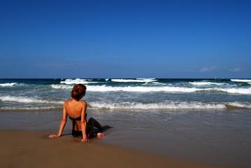 Woman on the beautiful beach of sea